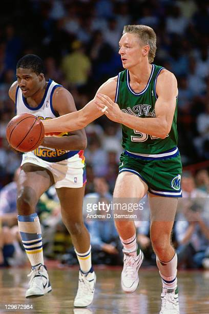 Detlef Schrempf of the Dallas Mavericks dribbles against the Denver Nuggets circa 1987 at McNichols Arena in Denver Colorado NOTE TO USER User...