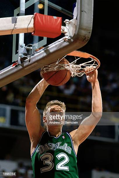 Detlef Schrempf of the Dallas Mavericks dunks during an NBA game NOTE TO USER User expressly acknowledges and agrees that by downloading and or using...