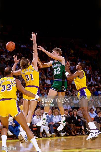 Detlef Schrempf of the Dallas Mavericks passes against the Los Angeles Lakers circa 1985 at the Great Western Forum in Inglewood California NOTE TO...