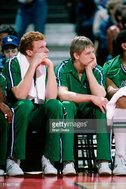 Detlef Schrempf of the Dallas Mavericks sits on the bench against the Portland Trailblazers at the Veterans Memorial Coliseum in Portland Oregon...