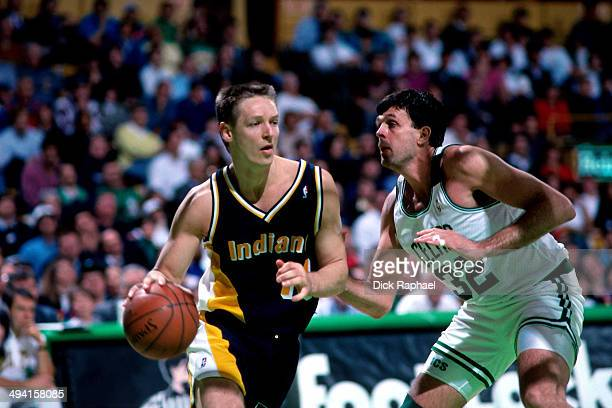 Detlef Schrempf of the Indiana Pacers drives against Kevin McHale of the Boston Celtics during a game played at the Boston Garden in Boston...