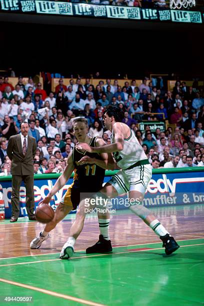 Detlef Schrempf of the Indiana Pacers drives against Kevin McHale of the Boston Celtics during a game played in 1992 at the Boston Garden in Boston...