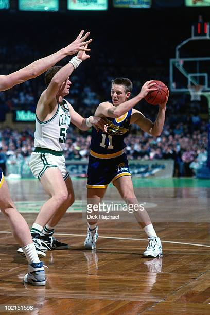 Detlef Schrempf of the Indiana Pacers looks to make a move against Joe Kleine of the Boston Celtics during a game played in 1990 at the Boston Garden...