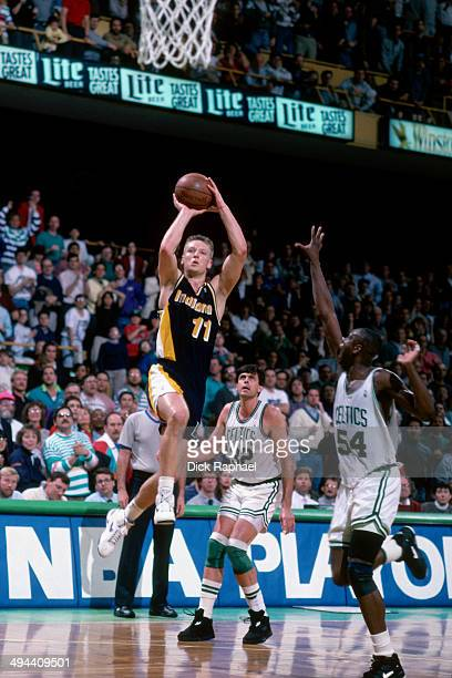 Detlef Schrempf of the Indiana Pacers shoots against the Boston Celtics during a game played in 1992 at the Boston Garden in Boston Massachusetts...
