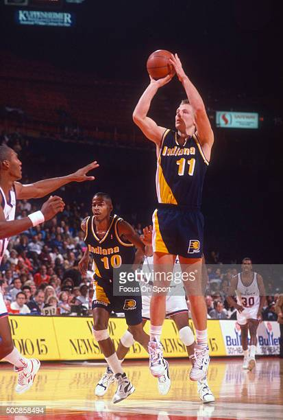 Detlef Schrempf of the Indiana Pacers shoots against the Washington Bullets during an NBA basketball game circa 1990 at the Capital Centre in...