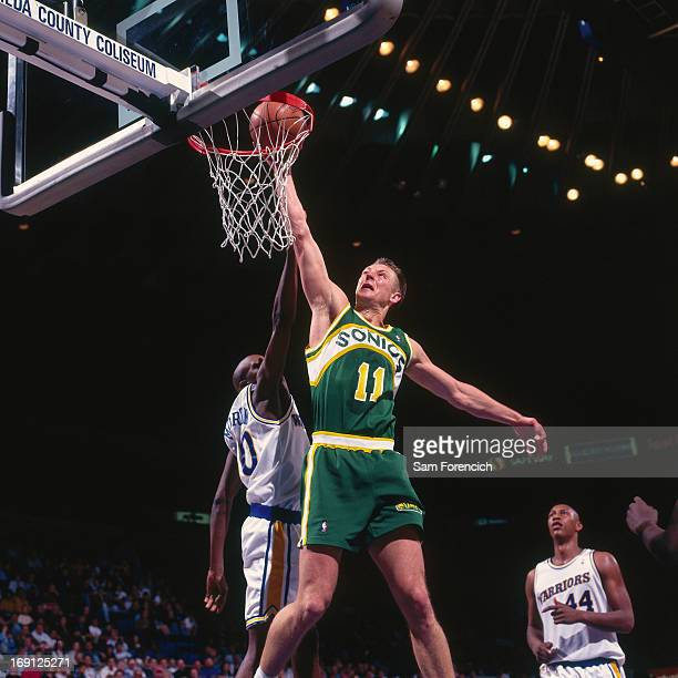 Detlef Schrempf of the Seattle Supersonics dunks against the Golden State Warriors circa 1995 at the OaklandAlameda County Coliseum Arena in Oakland...