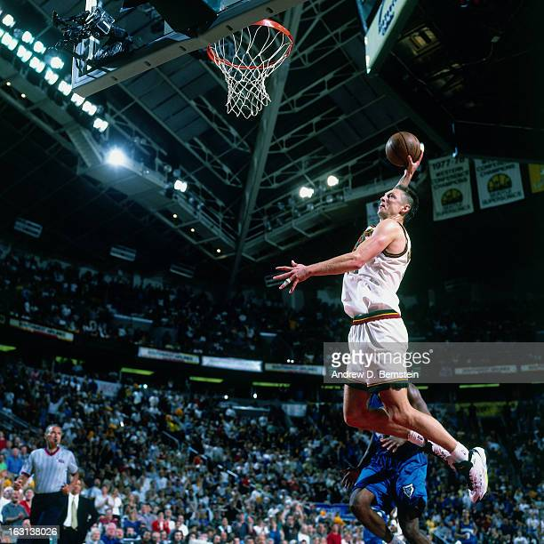 Detlef Schrempf of the Seattle Supersonics dunks against the Minnesota Timberwolves in Game Five of the Western Conference Quarterfinals as part of...