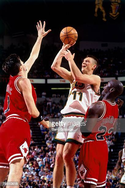 Detlef Schrempf of the Seattle SuperSonics goes up for a shot against Toni Kukoc and Michael Jordan of the Chicago Bulls in Game Four of the 1996 NBA...