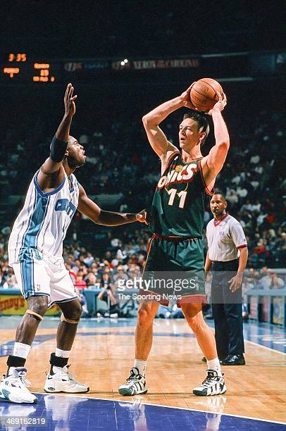 Detlef Schrempf of the Seattle Supersonics looks to move the ball against Glen Rice of the Charlotte Hornets during the game on March 6 1998 at...