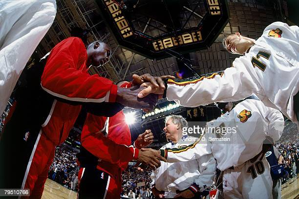 Detlef Schrempf of the Seattle SuperSonics shakes hands with Michael Jordan of the Chicago Bulls prior to Game Four of the 1996 NBA Finals at Key...