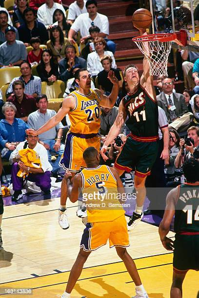 Detlef Schrempf of the Seattle Supersonics shoots against the Los Angeles Lakers in Game Four of the Western Conference Semifinals as part of the...