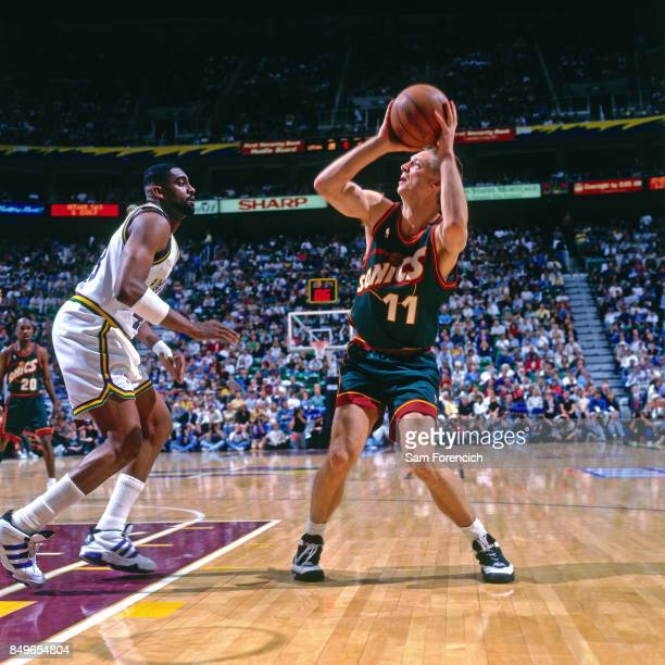 Detlef Schrempf of the Seattle SuperSonics shoots circa 1996 at the Delta Center in Salt Lake City Utah NOTE TO USER User expressly acknowledges and...