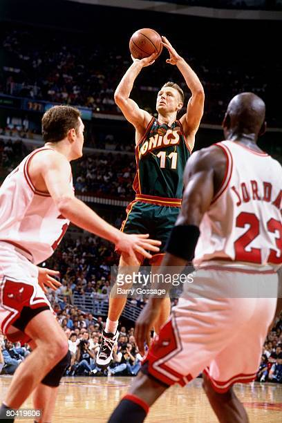 Detlef Schrempf of the Seattle SuperSonics shoots over Michael Jordan of the Chicago Bulls during Game Six of the 1996 NBA Finals at the United...
