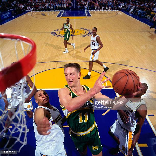 Detlef Schrempf of the Seattle Supersonics shoots the ball against the Golden State Warriors circa 1995 at the OaklandAlameda County Coliseum Arena...