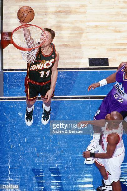 Detlef Schrempf of the Western Conference shoots against Tim Hardaway of the Eastern Conference during the 1997 AllStar Game on February 9 1997 at...