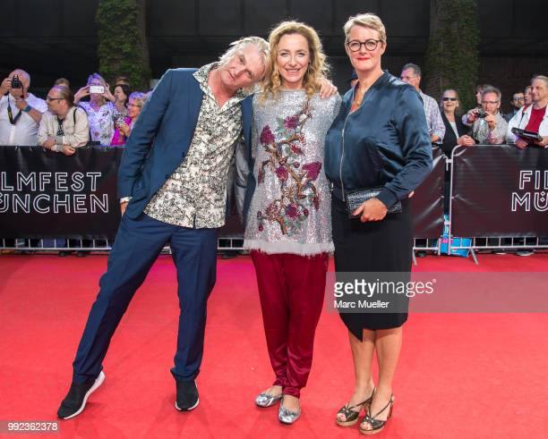 Detlev Buck Diana Illien and Viola Jaeger are seen at the red carpet before the premiere of the movie 'Asphaltgorillas' as part of the Munich Film...