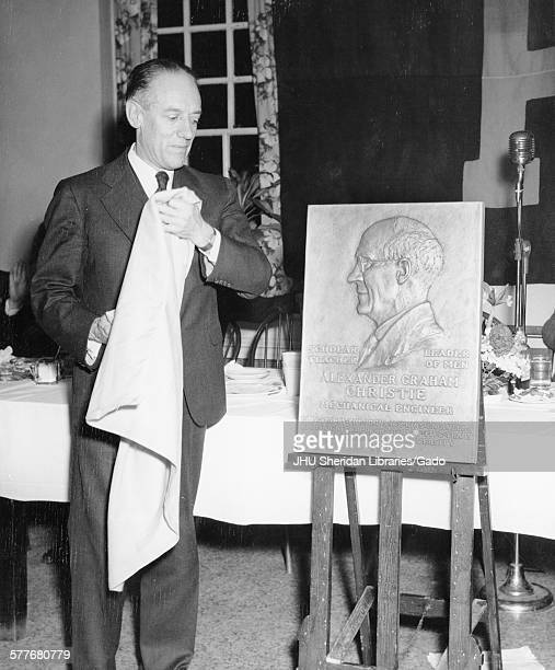 Detlev Wulf Bronk Commemoration Day Alexander Graham Christie Sculpture Candid photograph Bronk unveiling Alexander Graham Christie plaque at...