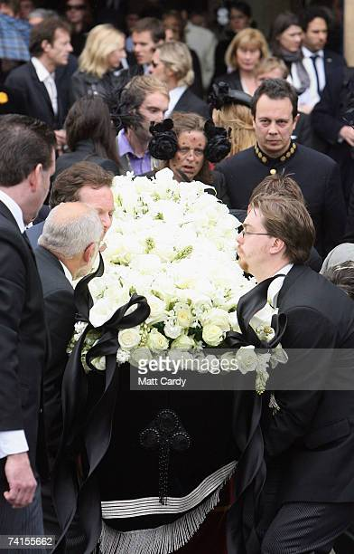 Detmar Blow watches as the coffin of his wife is lowered at the funeral service for fashion stylist Isabella Blow at Gloucester Cathedral on May 15...
