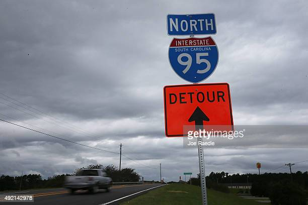 A detour sign helps drivers find their way around a closed I95 as a 13 mile portion of the major east coast highway continues to be closed due to...