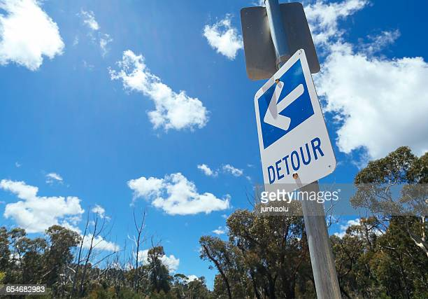 detour sign on post - detour sign stock photos and pictures