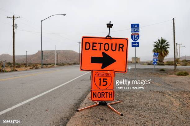 detour warning sign and information sign at glendale, nevada, usa - detour sign stock photos and pictures