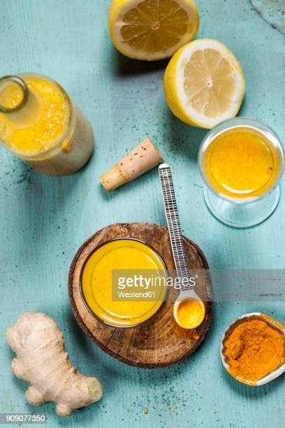 Detox drink, ginger, lemon and orange juice with curcuma and chilli powder