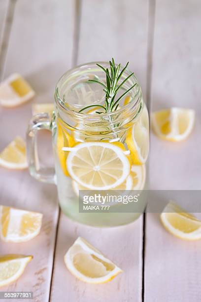 Detox water of lemon and rosemary in mason jar