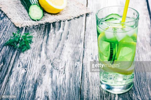 detox water with lemon,  cucumber and herbs - infused water stock pictures, royalty-free photos & images