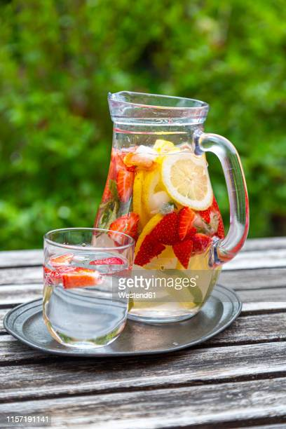 detox water with strawberry, lime, lemon and mint in a glass jar - infused water stock pictures, royalty-free photos & images