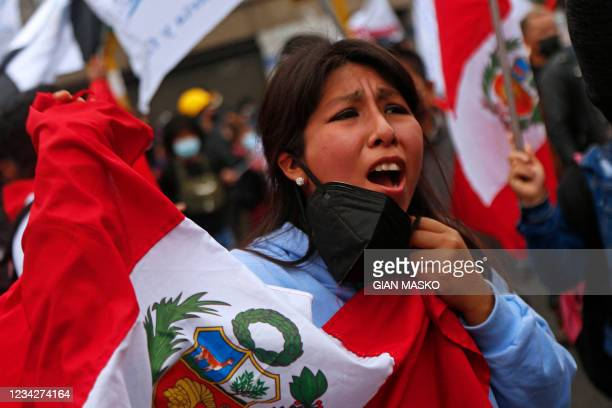 Detractor of the new Peruvian President Pedro Castillo takes part in a demonstration in Lima, on July 28, 2021. - Leftist Pedro Castillo was sworn in...