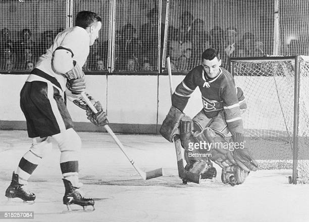 An Old Habit Ted Lindsay of the Detroit Red Wings watches the puck go in past goalie Jacques Plante of the Montreal Canadiens scoring his fourth goal...