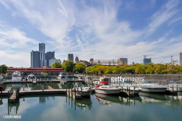 detroit and the marina - detroit river stock pictures, royalty-free photos & images