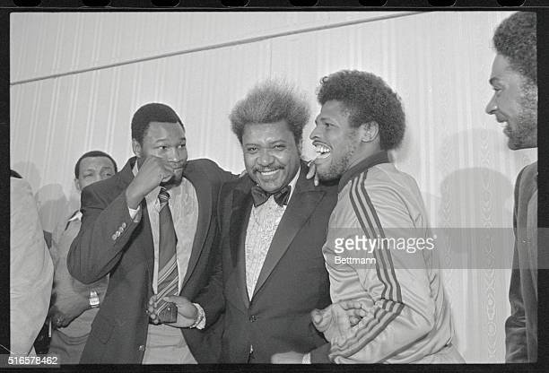 Detroit: Boxing promoter Don King stands in between Heavyweight champ Larry Holmes and Leon Spinks after it was announced May 6 Holmes will defend...