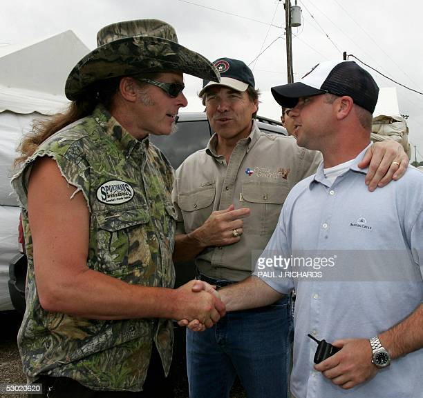 Detroit City hard hocker Ted Nugent is introduced to Josh Gatlin son of Country music star Larry Gatlin by Texas Governor Rick Perry 04 June 2005 in...