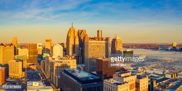 detroit downtown michigan at sunset in winter - detroit skyline stock pictures, royalty-free photos & images