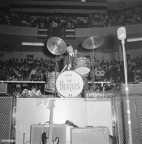 Drummer Ringo Starr seems to be putting quite a bit of spirit into his work as he beats out a tune during a Beatle's concert here 9/6