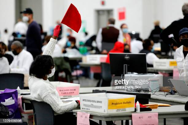 Detroit election worker seeks assistance while working on counting absentee ballots for the 2020 general election at TCF Center on November 4, 2020...