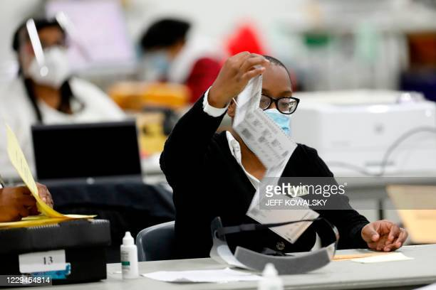 Detroit election workers work on counting absentee ballots for the 2020 general election at TCF Center on November 4, 2020 in Detroit, Michigan. -...