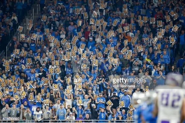 """Detroit fans hold up placards with the number """"3"""" on a third down defensive play during game action between the Minnesota Vikings and the Detroit..."""