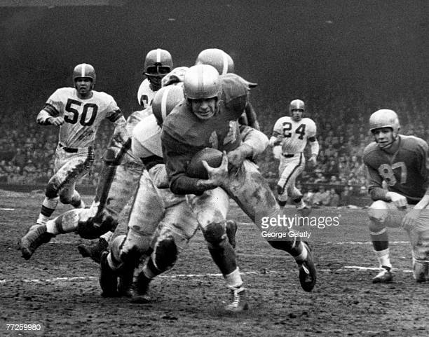 Detroit Lions back Bob Hoernschemeyer on a carry in a 1716 win over the Cleveland Browns in a League Championship game on December 27 1953 at Briggs...