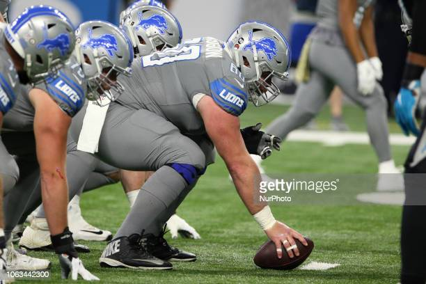 Detroit Lions center Graham Glasgow prepares to snap the ball during the first half of an NFL football game against the Carolina Panthers in Detroit...
