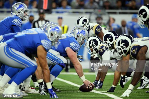Detroit Lions center Graham Glasgow prepares to snap the ball during the first half of an NFL football game against the Los Angeles Rams in Detroit...