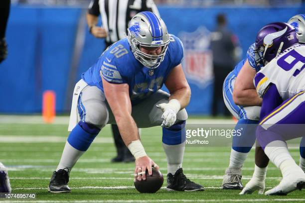 Detroit Lions center Graham Glasgow prepares to snap the ball during the first half of an NFL football game against the Minnesota Vikings in Detroit...