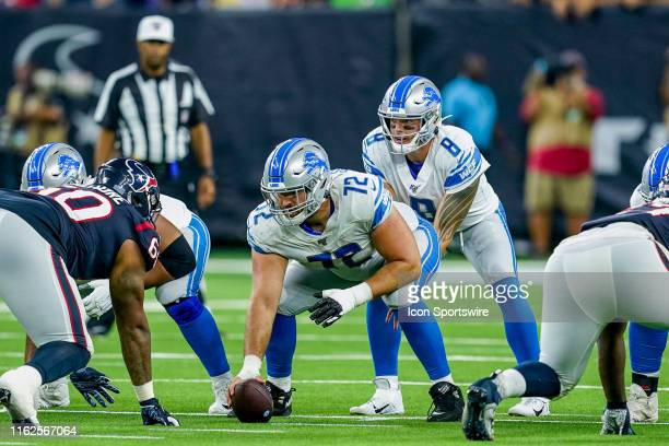 Detroit Lions center Luke Bowanko gets ready to snap the ball to quarterback David Fales during a NFL preseason game between the Detroit Lions and...