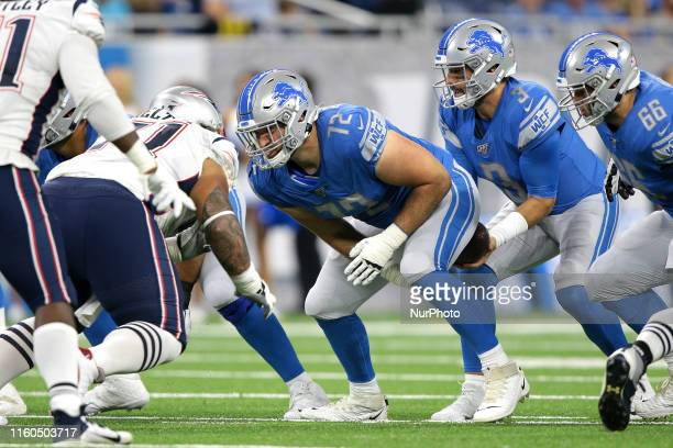Detroit Lions center Luke Bowanko snaps the ball during the first half of an NFL football game against the New England Patriots in Detroit Michigan...