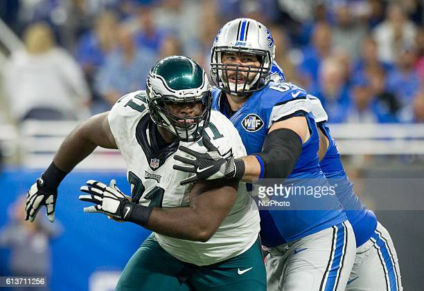 Detroit Lions center Travis Swanson defends against Philadelphia Eagles defensive tackle Fletcher Cox during the second half of an NFL football game...