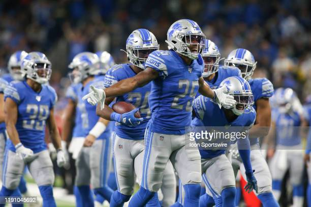 Detroit Lions cornerback Darius Slay celebrates making a interception during a regular season game between the Green Bay Packers and the Detroit...