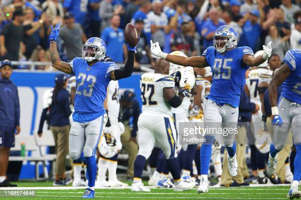 Detroit Lions cornerback Darius Slay celebrates with Detroit Lions defensive end Romeo Okwara after Slay intercepted a pass during the second half of...