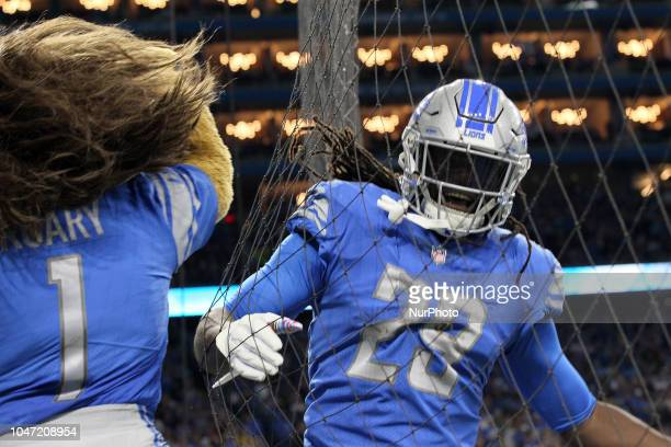 Detroit Lions cornerback Darius Slay celebrates with Roary the Detroit Lions mascot a touchdown scored by running back LeGarrette Blount during the...
