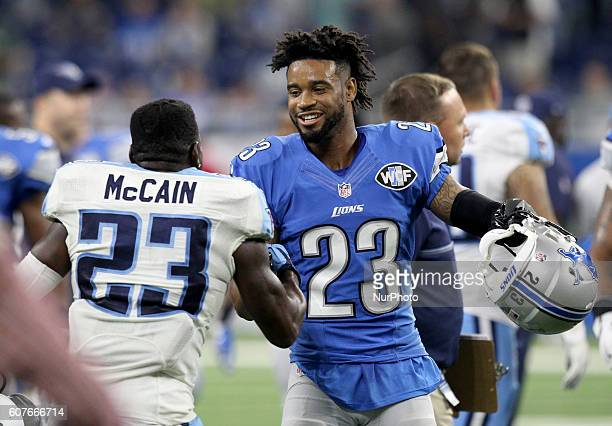 Detroit Lions cornerback Darius Slay greets Tennessee Titans defensive back Brice McCain after an NFL football game in Detroit Michigan USA on Sunday...